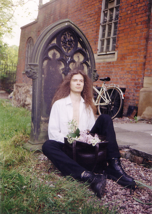 Spiros Doikas at a cemetery near Owens Park, Manchester (1995).